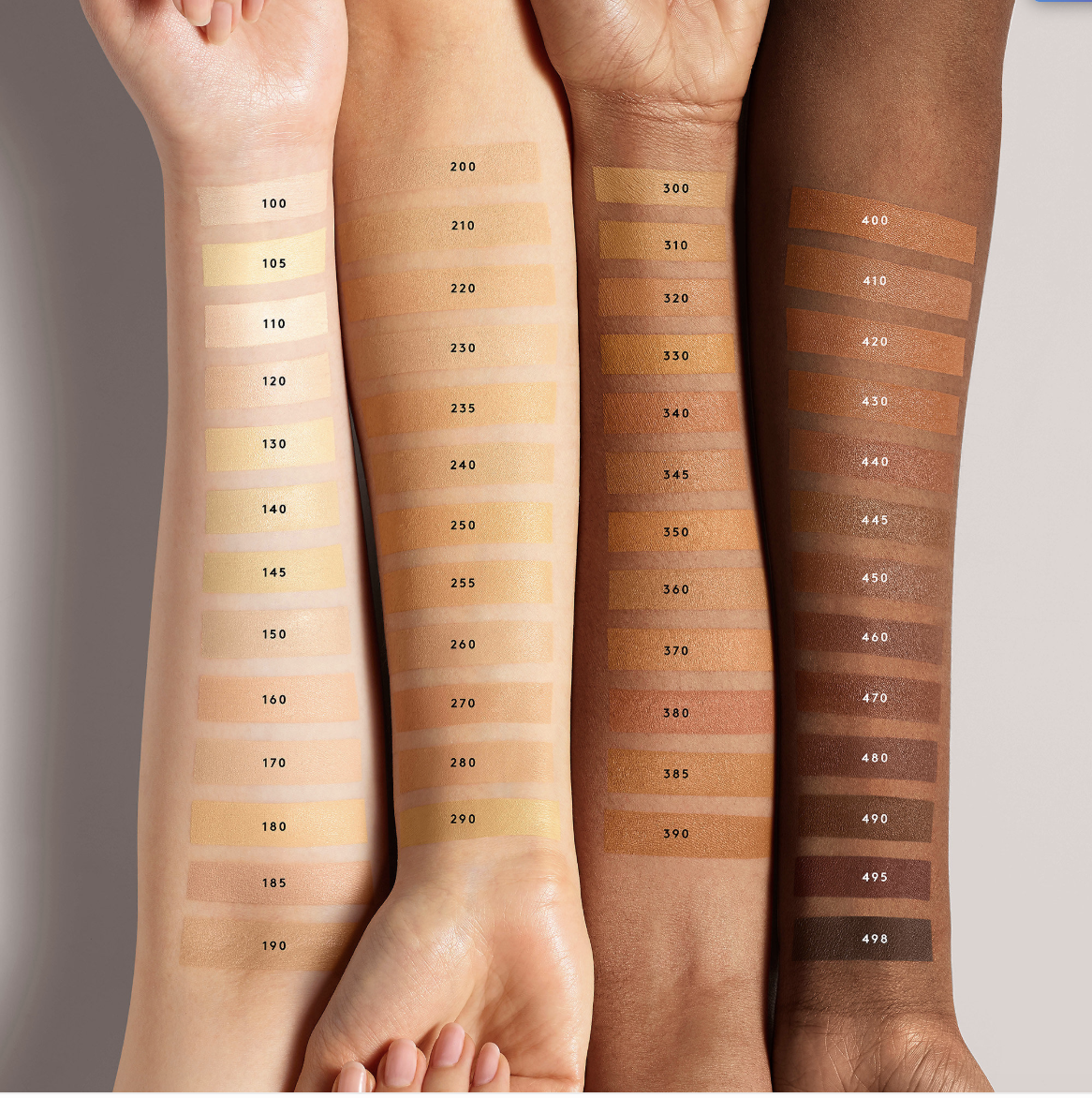 A photo of four arms showing off 50 swatches of Fenty Beauty's new Pro Filt'r Hydrating Longwear Foundation.