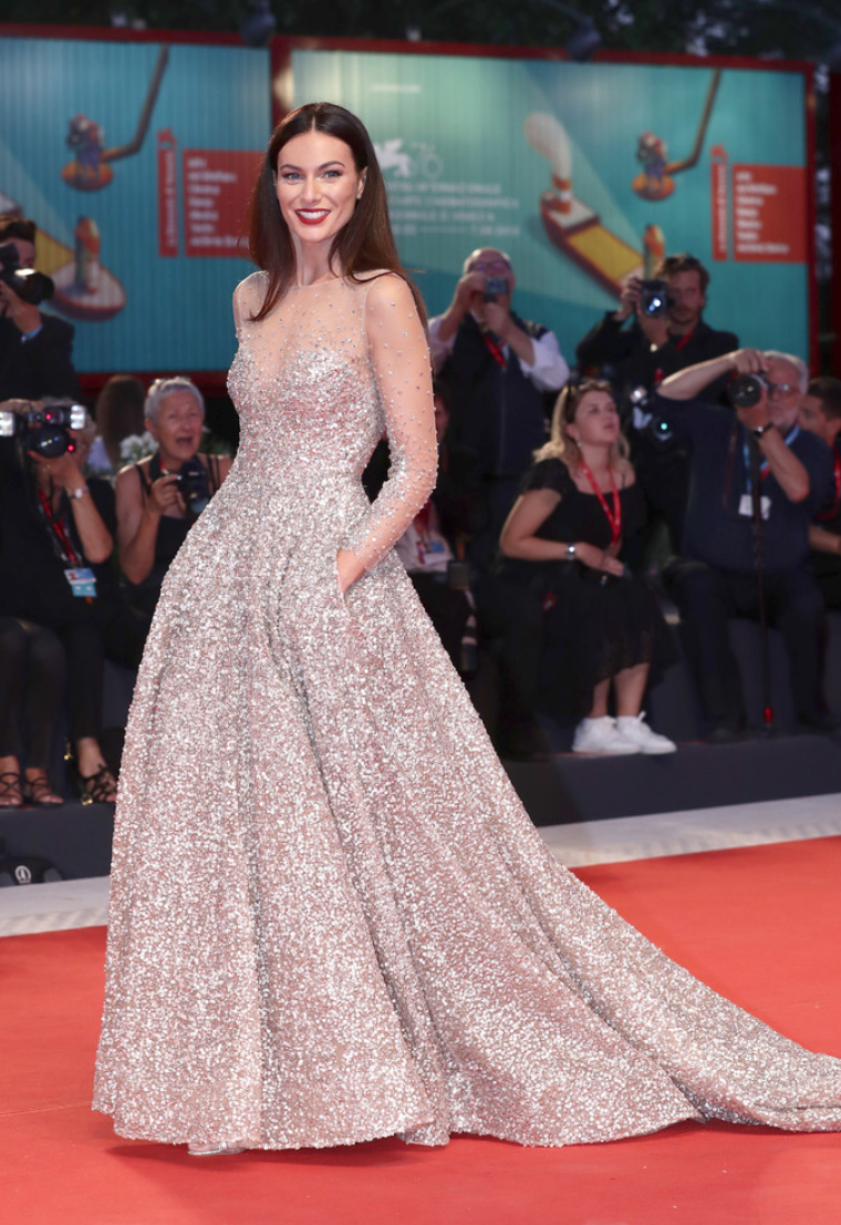 Paola Turani walks the red carpet at the Venice Film Festival in a sparkling silver gown