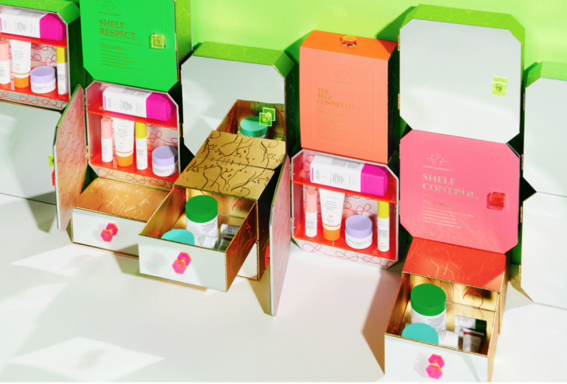"A brightly colored image of various Drunk Elephant products, demonstrating the aesthetic that makes the brand popular in ""shelfie"" influencer posts."